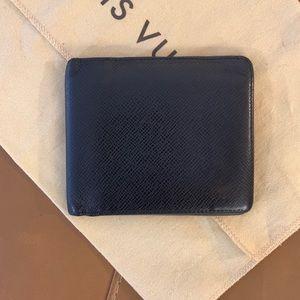 Authentic LOUIS VUITTON Black Taiga Leather Bifold